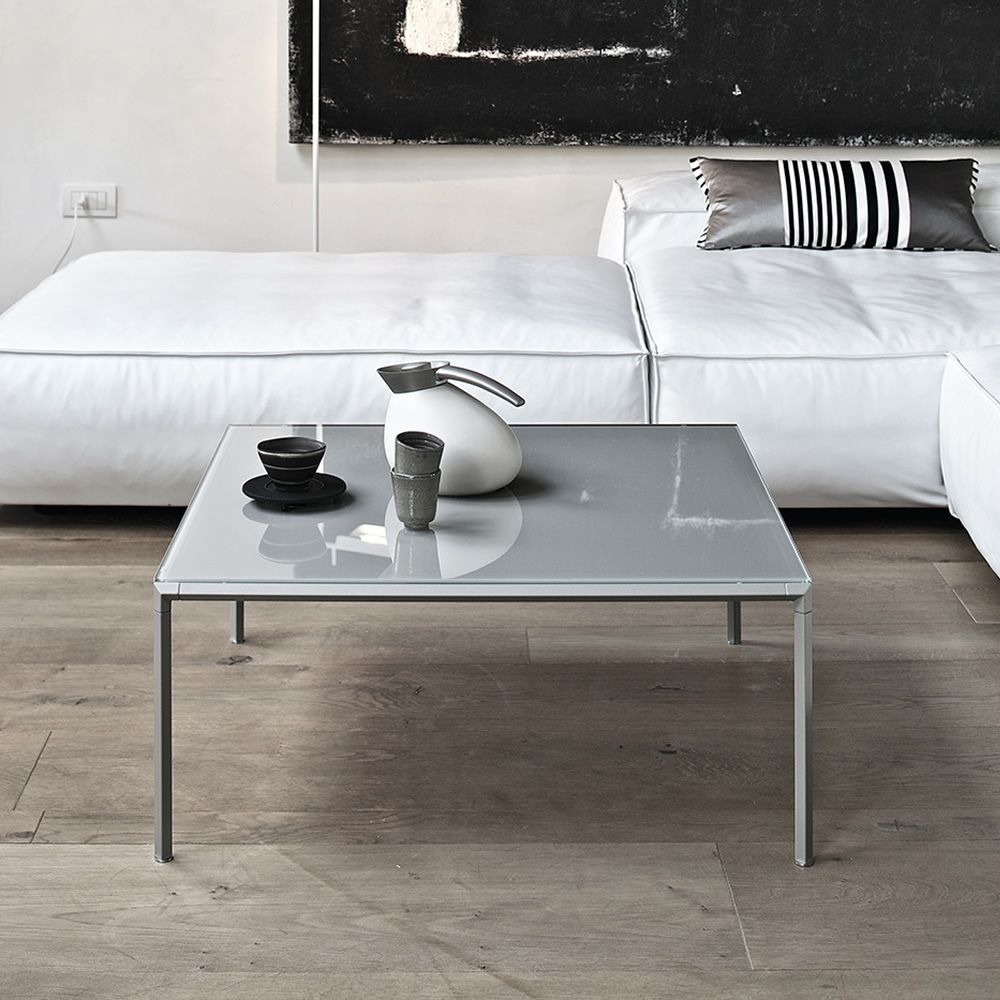 Coffee table with sand colour lacquered structure and glossy dove grey lacquered glass top