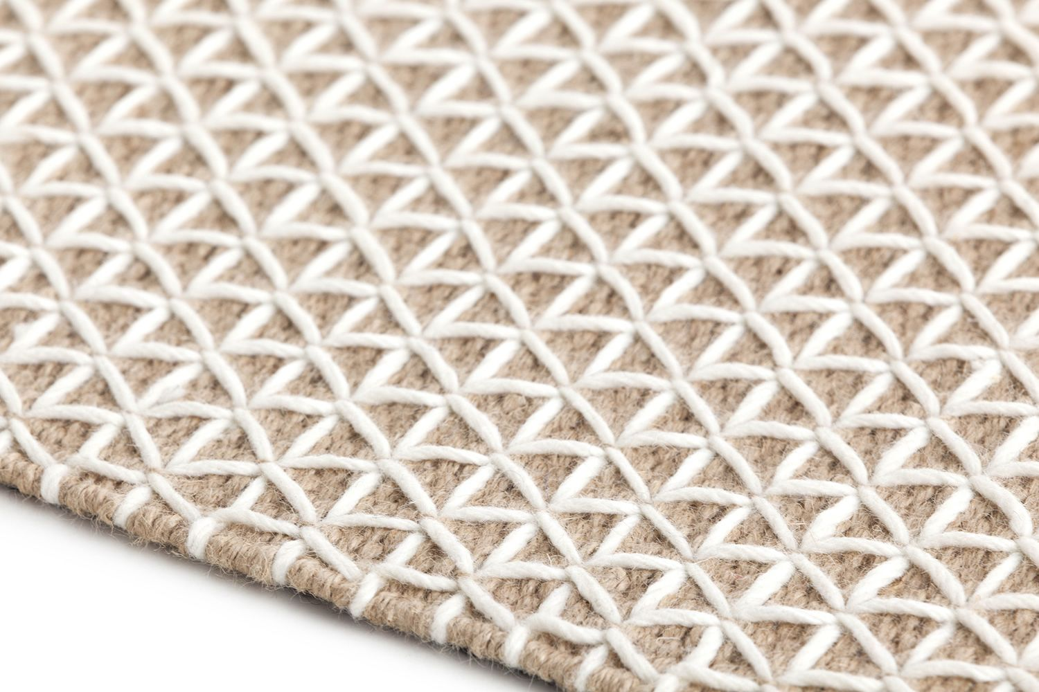 Detail of the rug in white colour