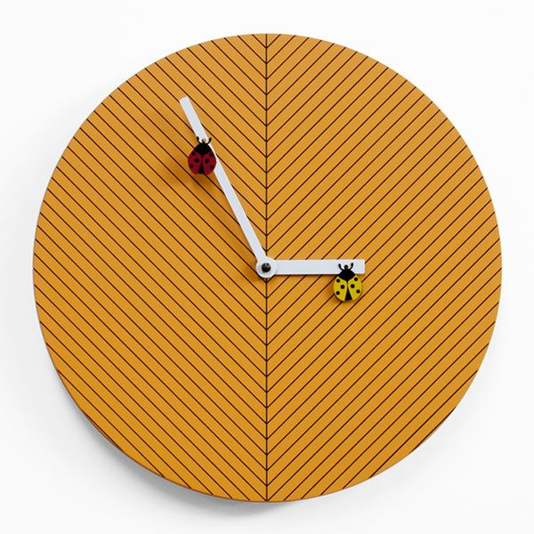 Wall clock in wood, yellow colour