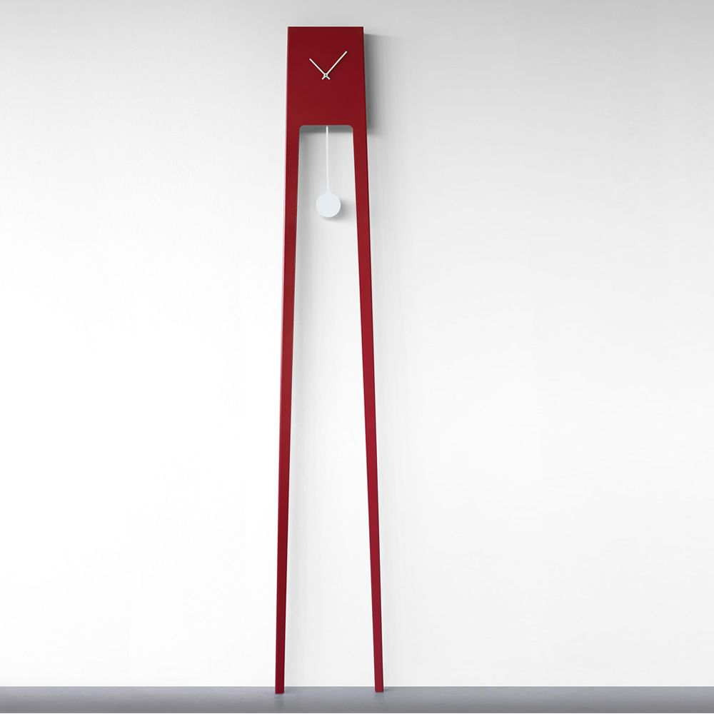 Wall clock made of varnished metal, red colour