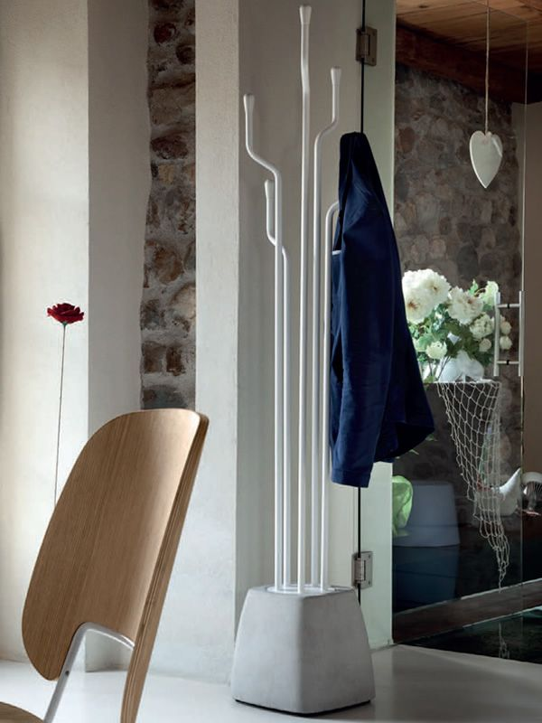 Coat hanger made of cement and white varnished steel, knobs in white lacquered wood