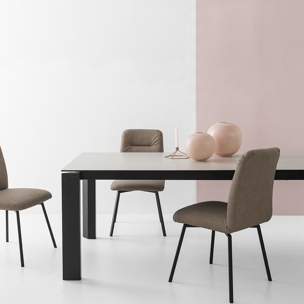 Extendable table made of black varnished metal, with ceramic top, salt colour