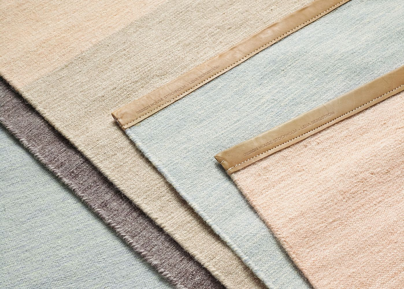 Detail: rugs in pure wool with leather edges