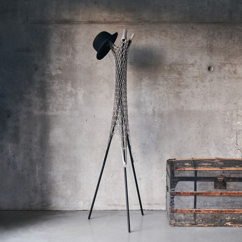 Modern coat rack in black varnished metal and TK regenerated hide