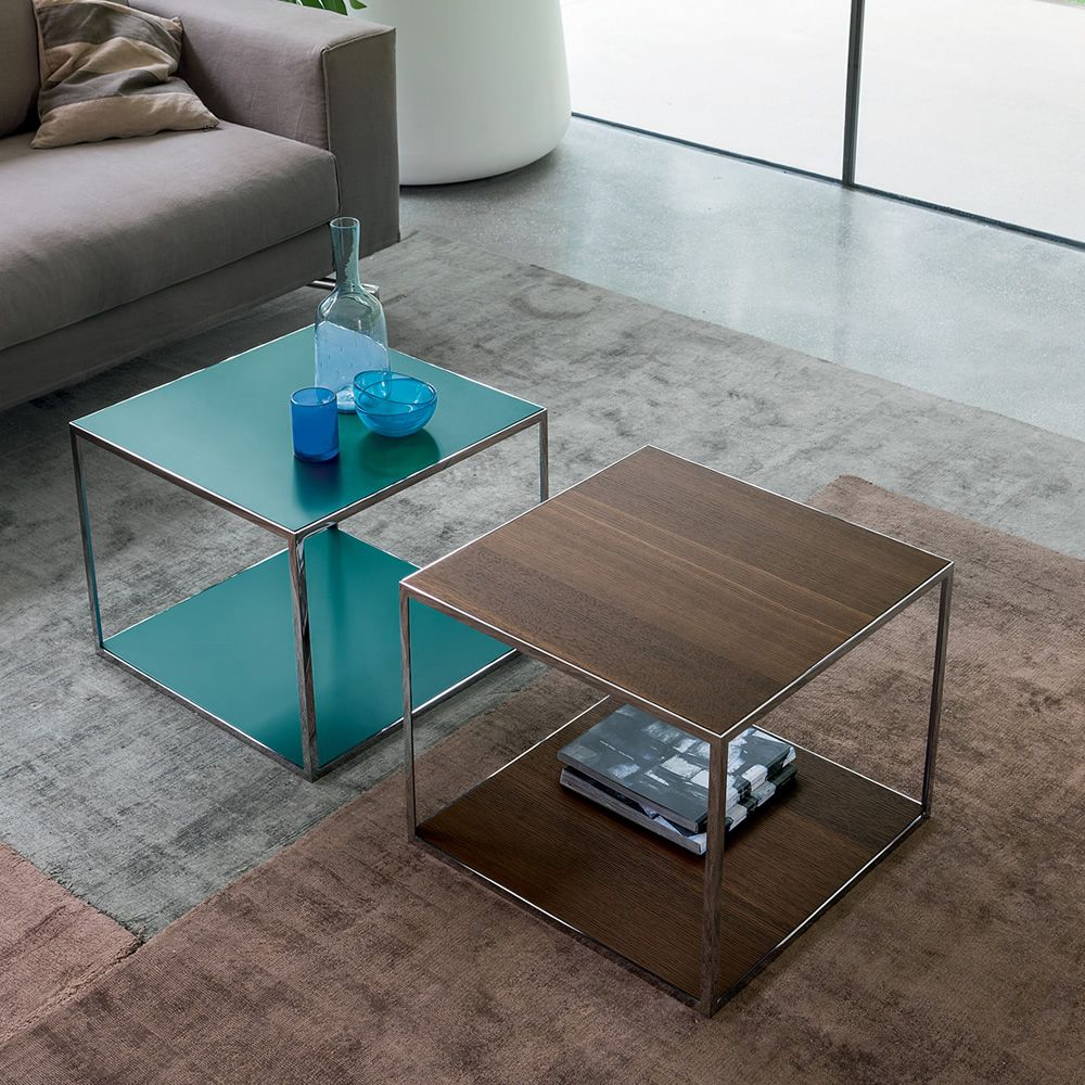 Coffee tables in chormed metal, top made of veneered wood in heat treated oak und in matt Garda grey colour lacquered