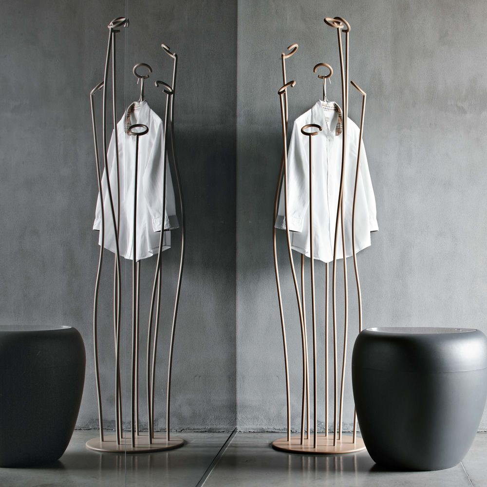 Design coat hanger made of beige lacquered metal