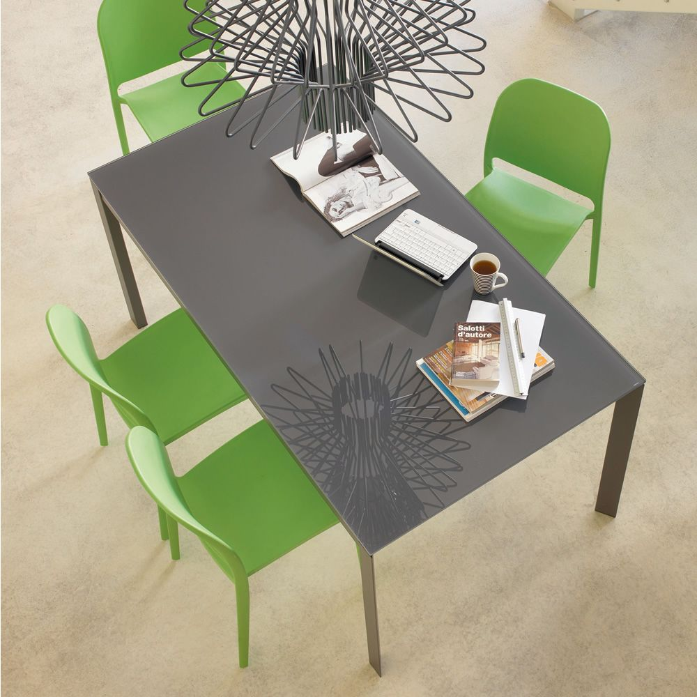 Open table in metal, lacquered anthracite grey, and top in glossy anthracite grey lacquered glass