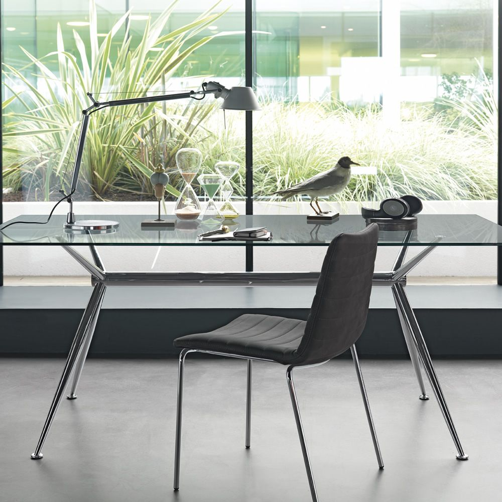 Fixed table made of chromed metal with transparent glass top