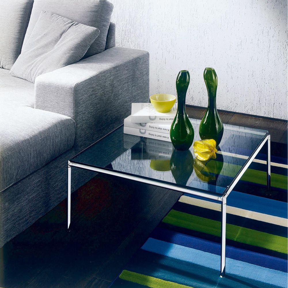 Coffee table with chromed steel frame, transparent glass top