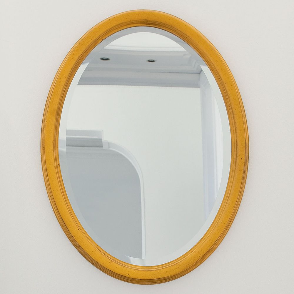 Oval mirror with classic frame made of honey yellow lacquered old-looking wood