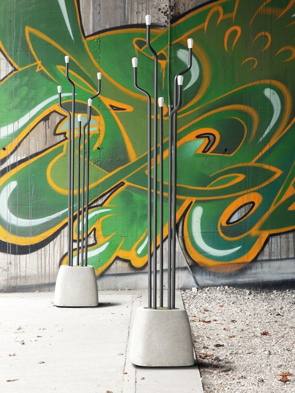 Coat hanger made of cement and anthracite grey varnished steel, knobs in white lacquered wood