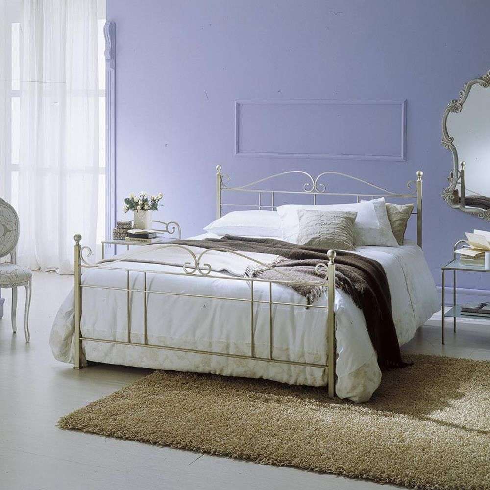 Double bed in gold coated silver finish iron