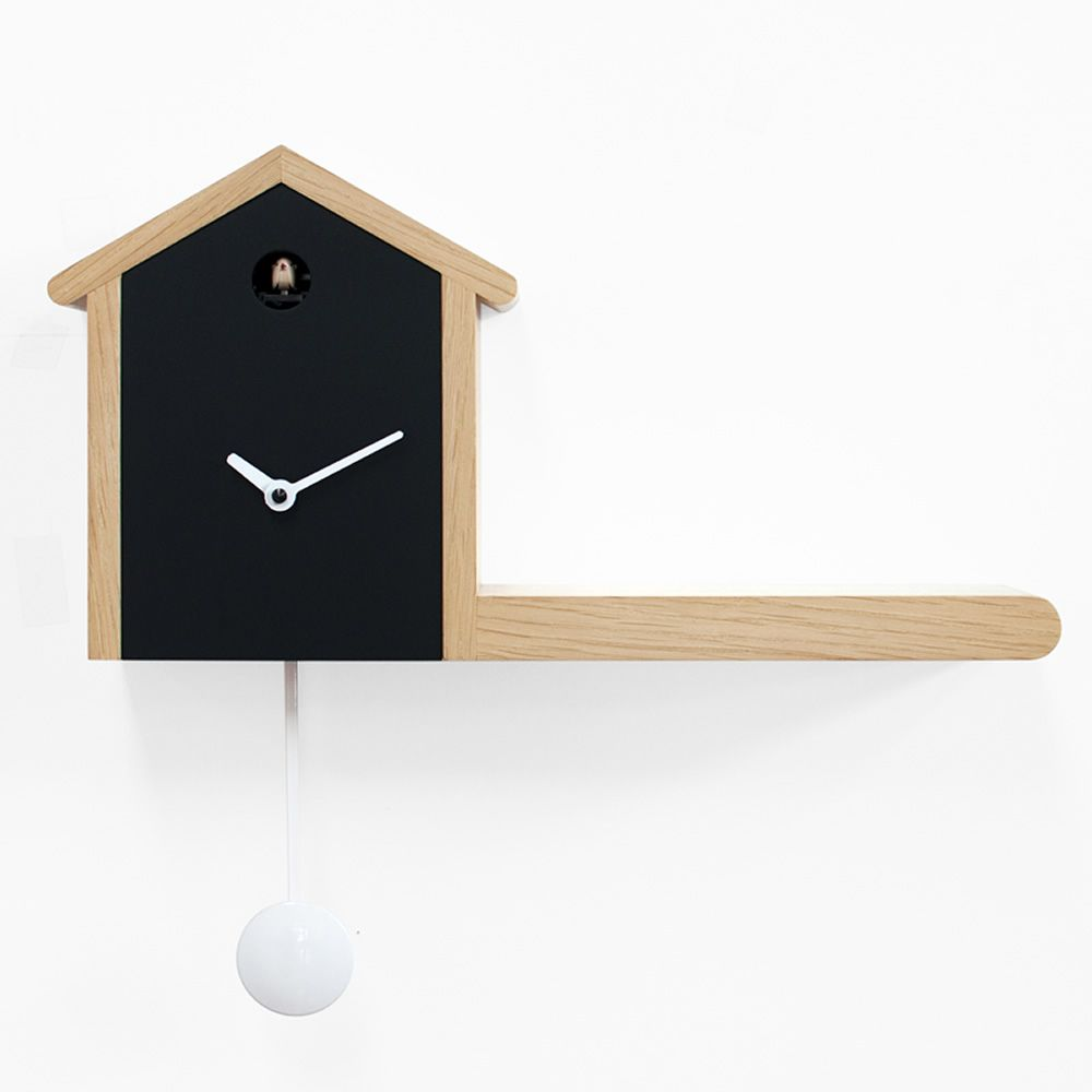 Cuckoo clock made of wood, clock face/front of the house in black colour, contour and shelf in natural colour