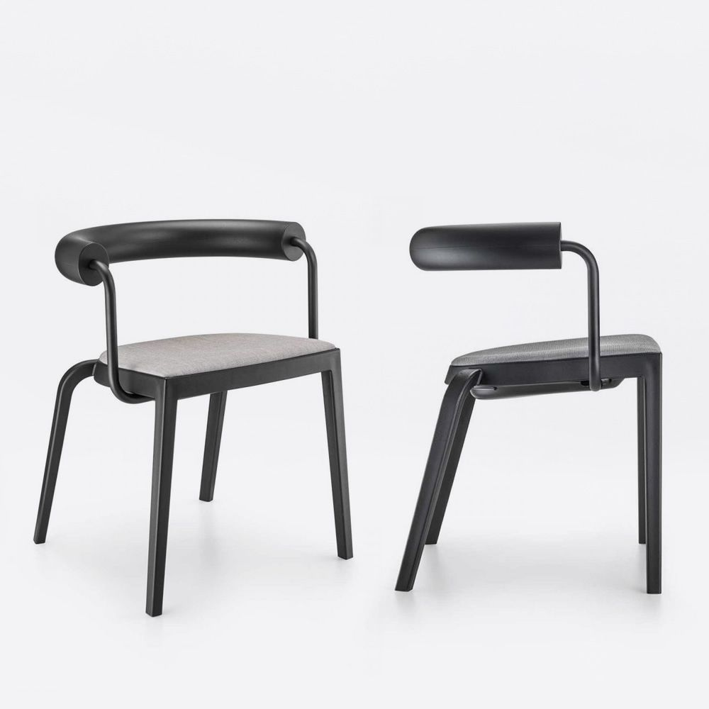 Chair made of black polypropylene, backrest in black polyurethane and black varnished steel, seat covered with fabric, leather or imitation leather (on request)