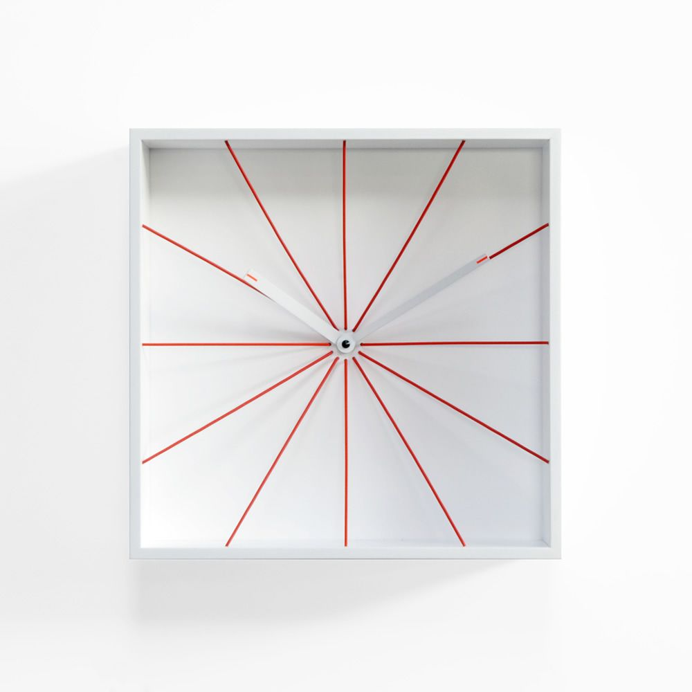 Wall clock made of white varnished wood