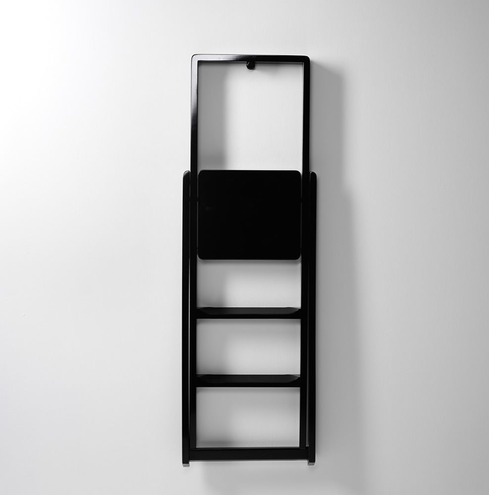 Folding stepladder made of black lacquered beech wood, hung on the wall by means of hook (included)
