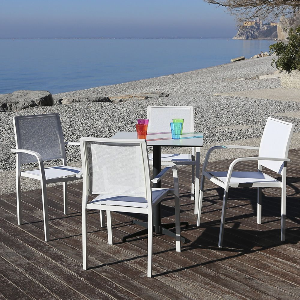 Stackable chairs made of white varnished aluminium, seat and backrest in white net