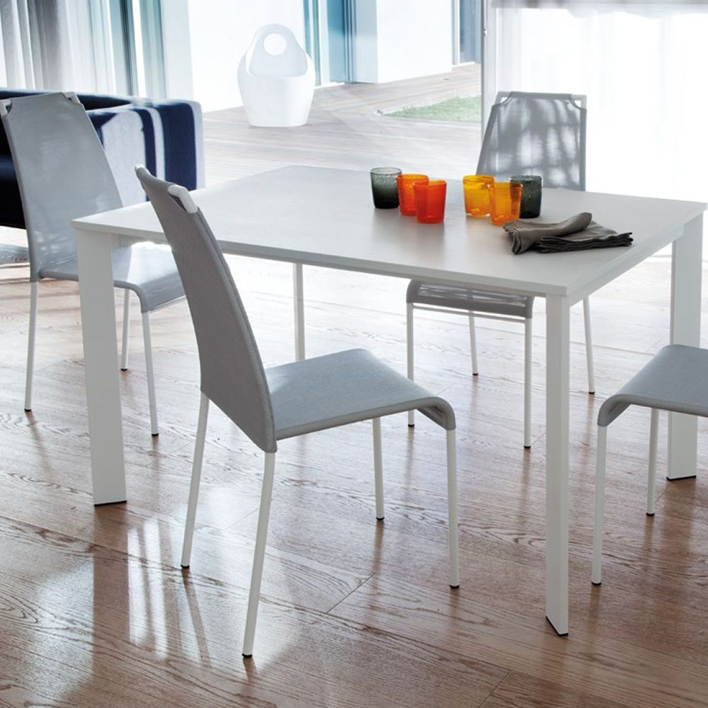 Extendable table made of white lacquered metal with white melamine top