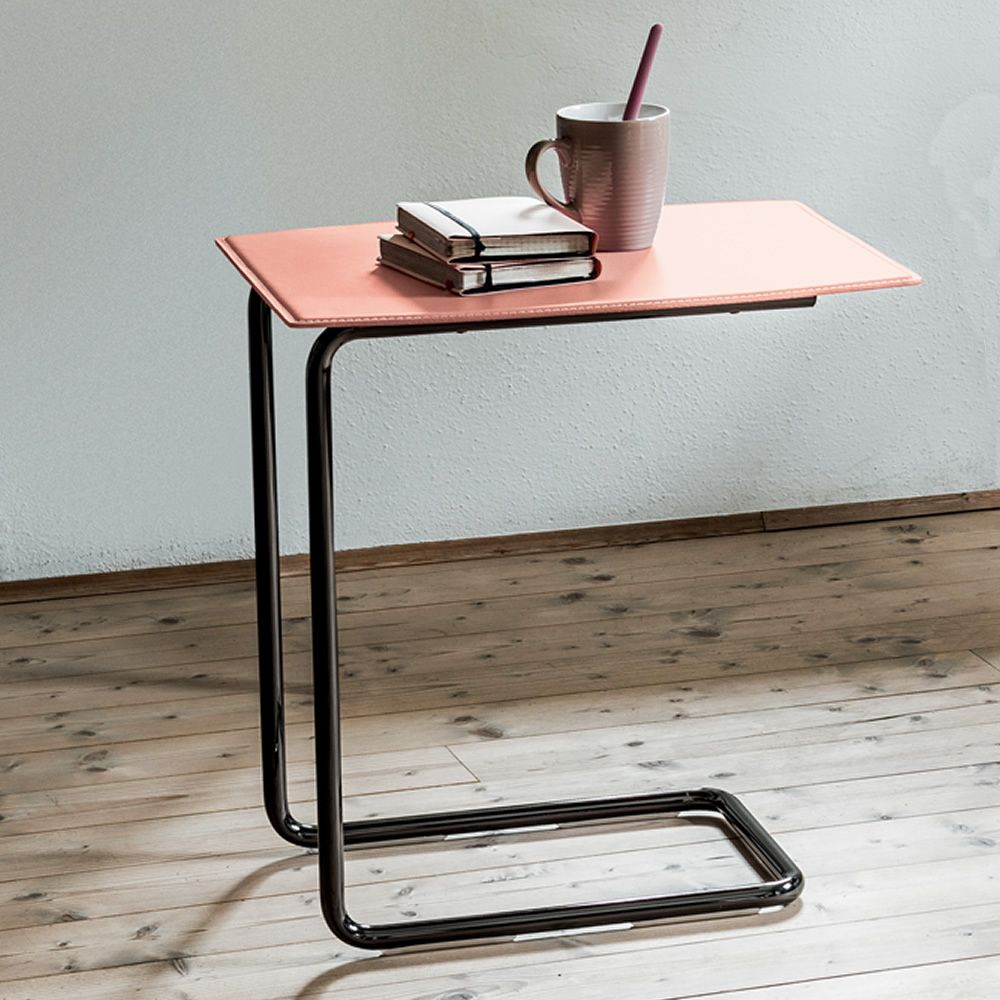 Design side table made of black nichel with natural hide top in facepowder pink colour