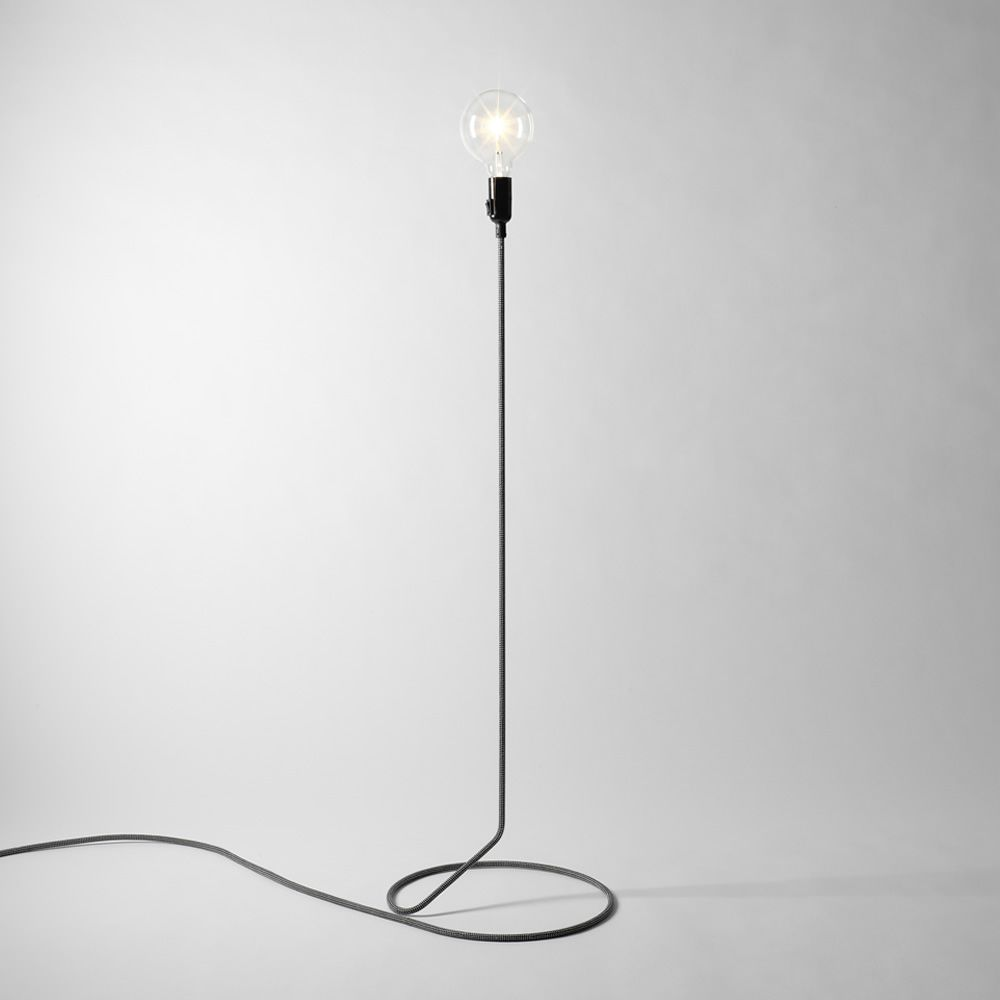 Design floor lamp, with textile cord on steel tube