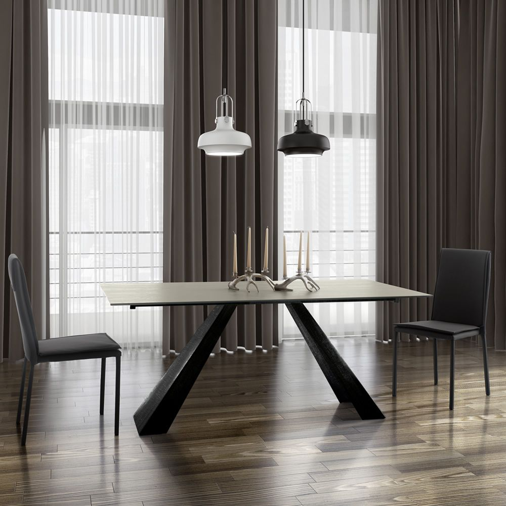 Metal table varnished in steel colour, with ceramic top in cement finish
