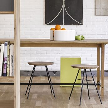 Disc - Stools made of black lacquered metal with oak seat