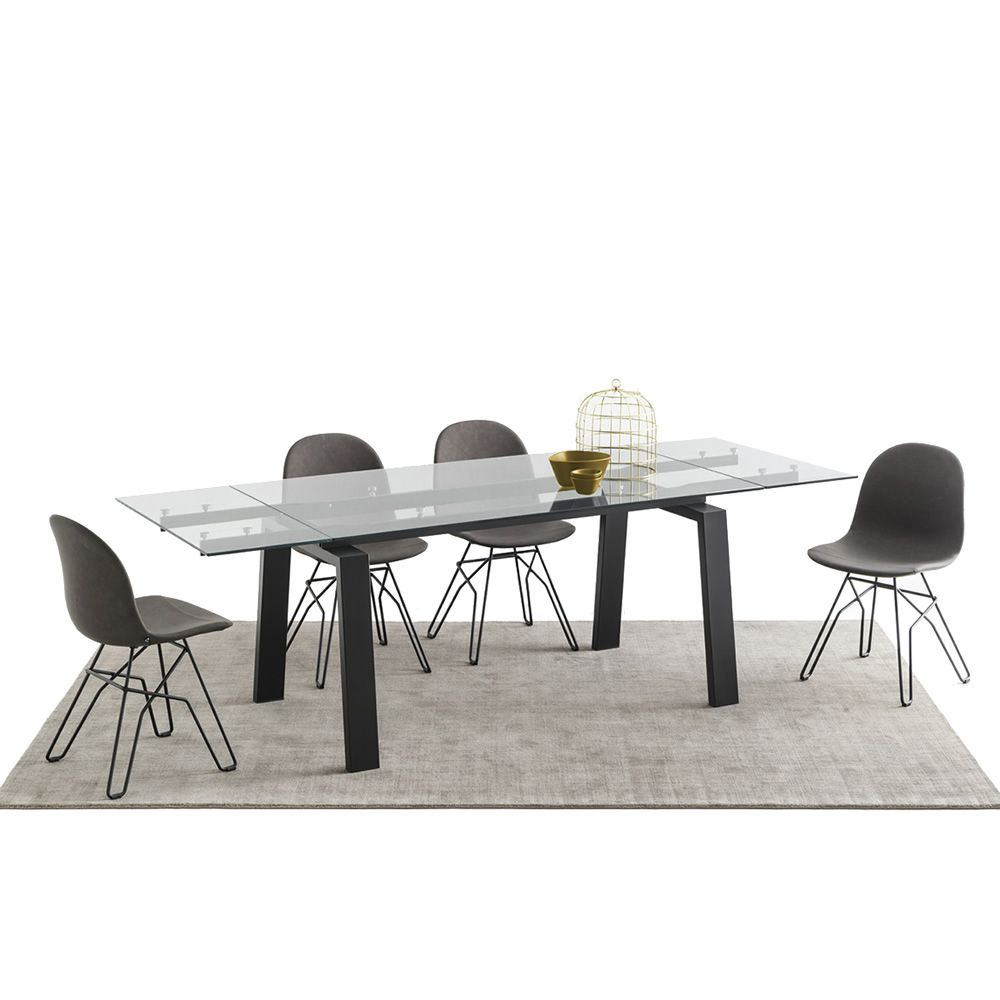Extendible table in black varnished metal, with glass top