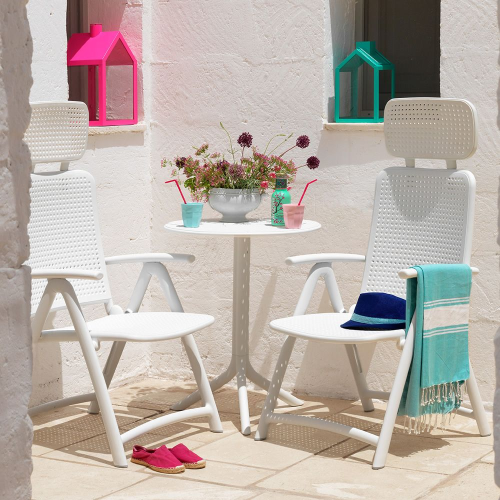 Polypropylene armchairs in white colour, matching with Step table