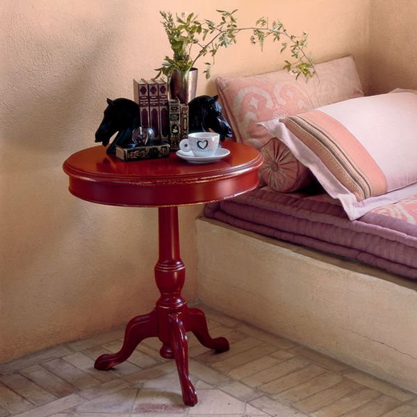Classic side table made of red lacquered wood