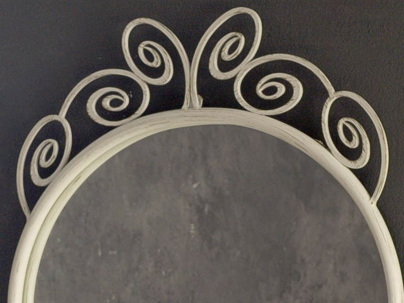 Detail of the iron mirror in white with golden effect varnished