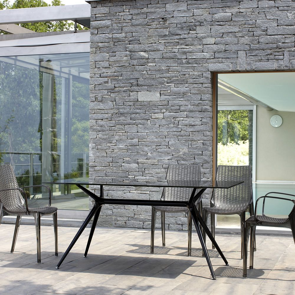 Design table, with a glass grey fumè top