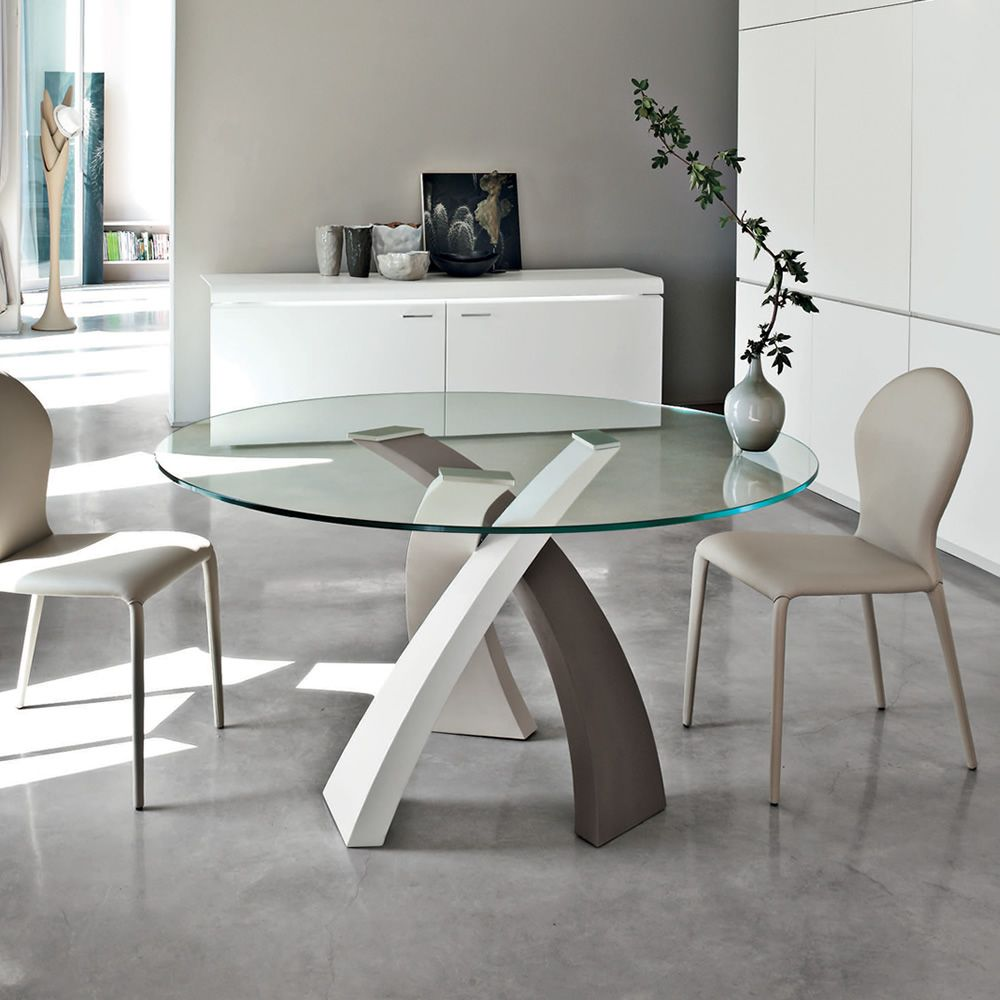 Round table made of three-coloured lacquered metal with glass top