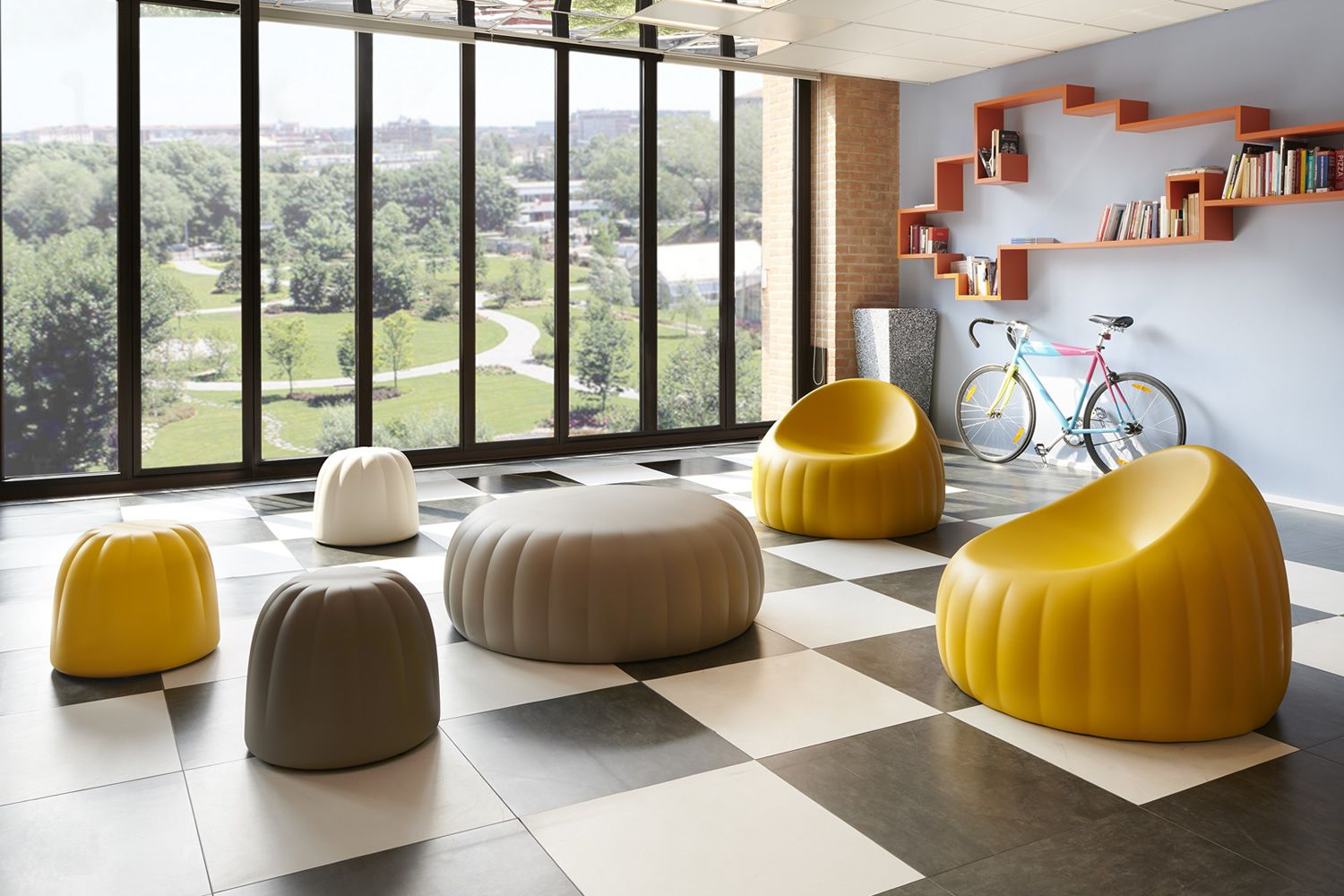 Design armchairs in soft polyurethane, yellow colour, matched with Gelée pouf