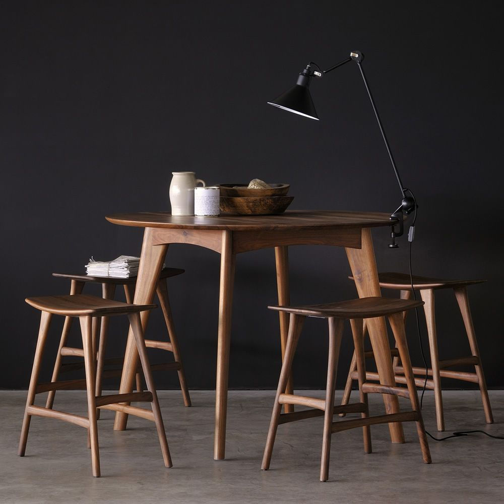 High table made of Canaletto walnut, matched with Osso-SG stools