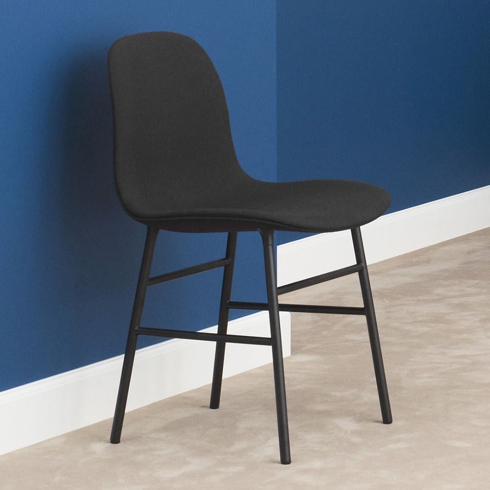 Chair made of black lacquered metal with padded seat
