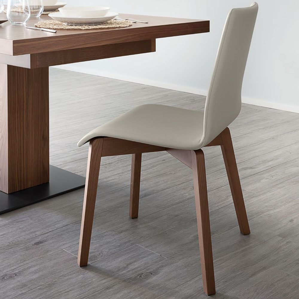 Chair made of beech wood in walnut colour, seat covered with beige imitation leather