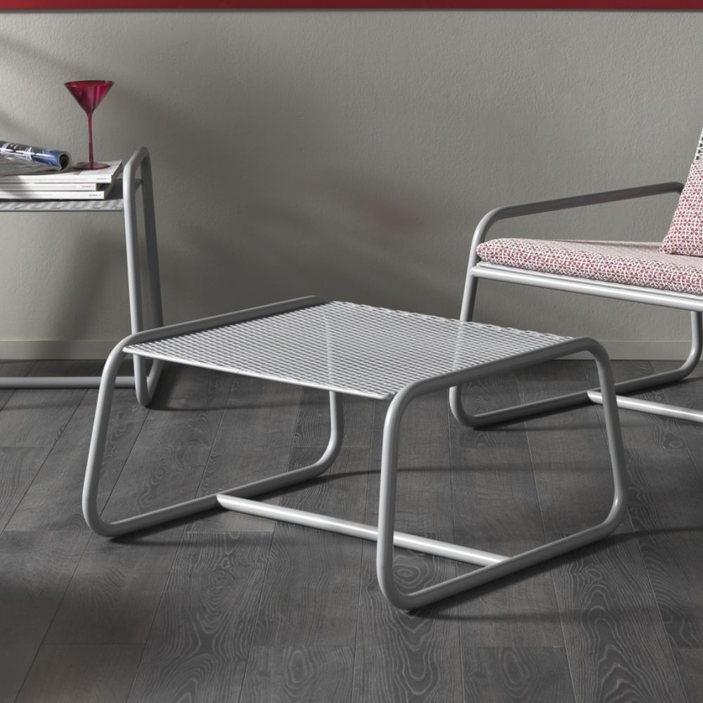 Table - footrest in steel and metal mesh. Light grey colour