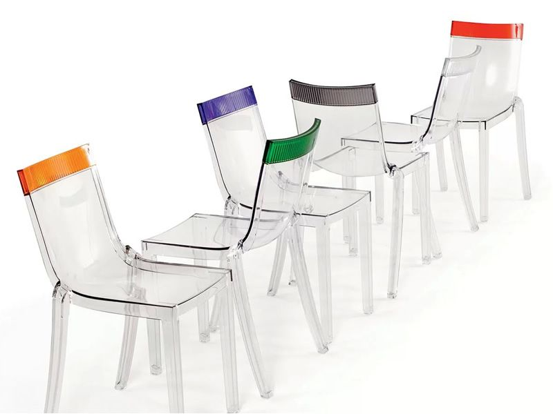 Kartell design chairs with transparent structure and backrest's top in several colours