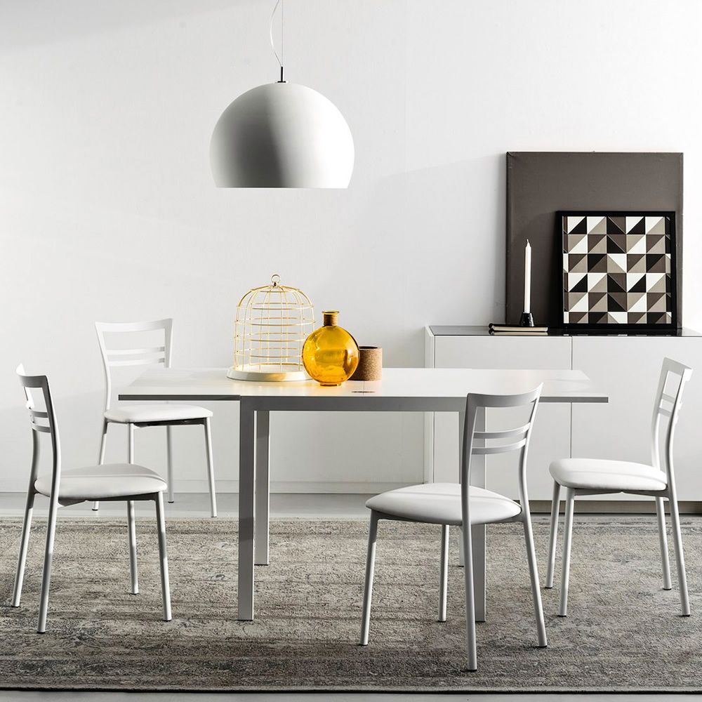 Extendable table made of satin varnished metal with melamine top in opaque optic white colour, matched with CB1419 Go! chairs