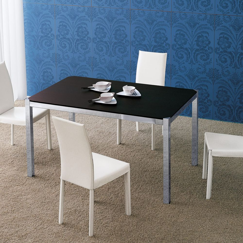Extendable table made of chromed metal with veneered wood top in dark brown oak colour