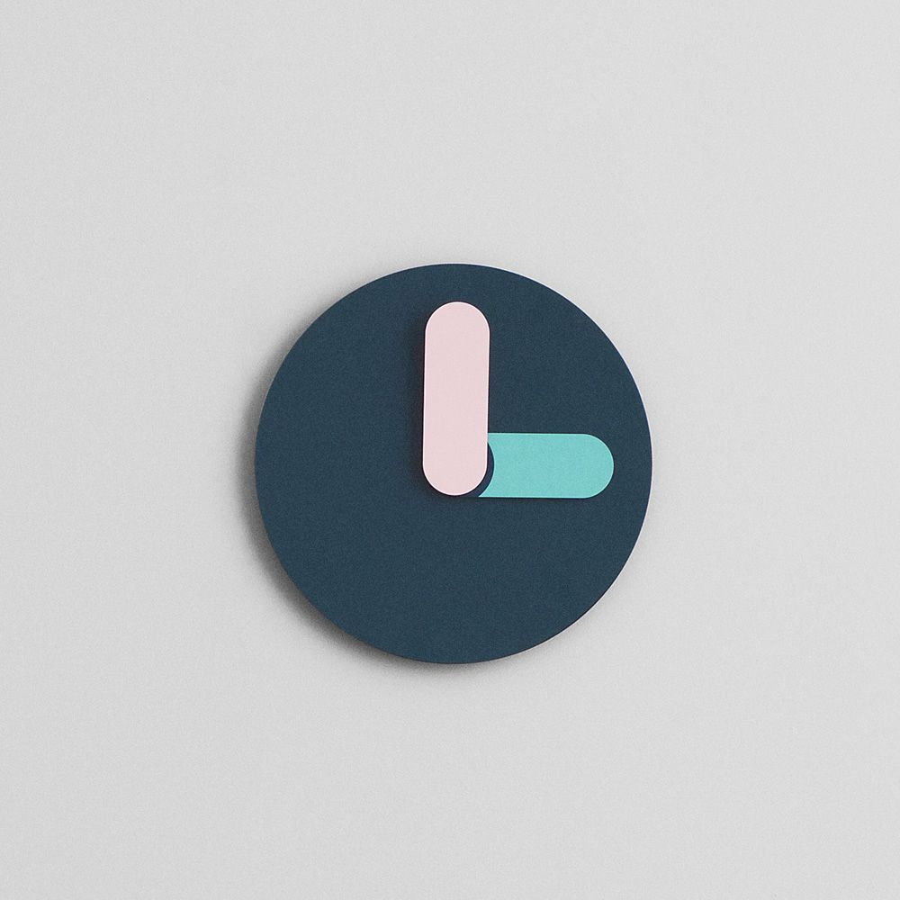Wall clock made of lacquered aluminium in petroleum blue colour with pink and green clock hands