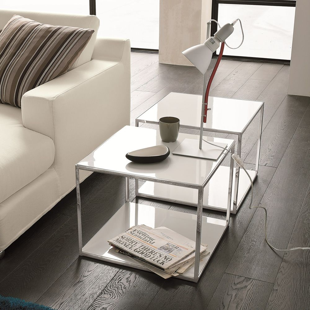 Coffee tables made of chromed metal, top in white lacquered veneered wood (glossy finish on request)