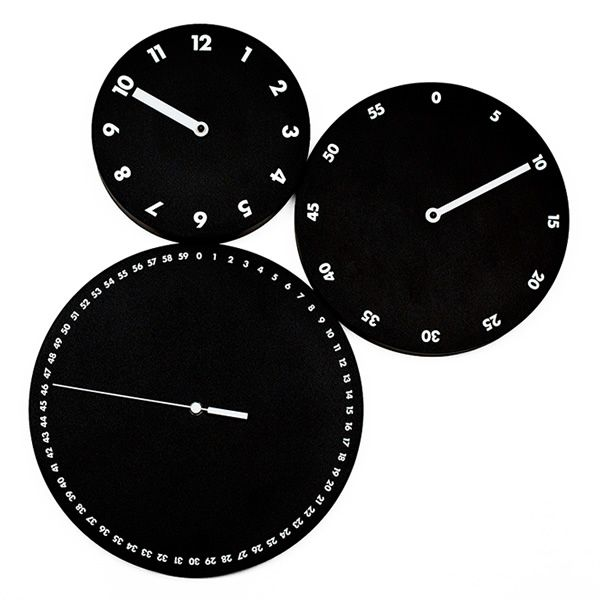 Wall clock in black colour wood