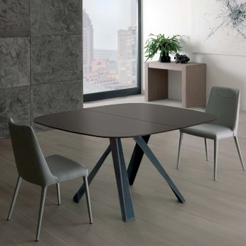 Bombo A - Extendable table with raw iron varnished metal structure, glass top in dark brown colour