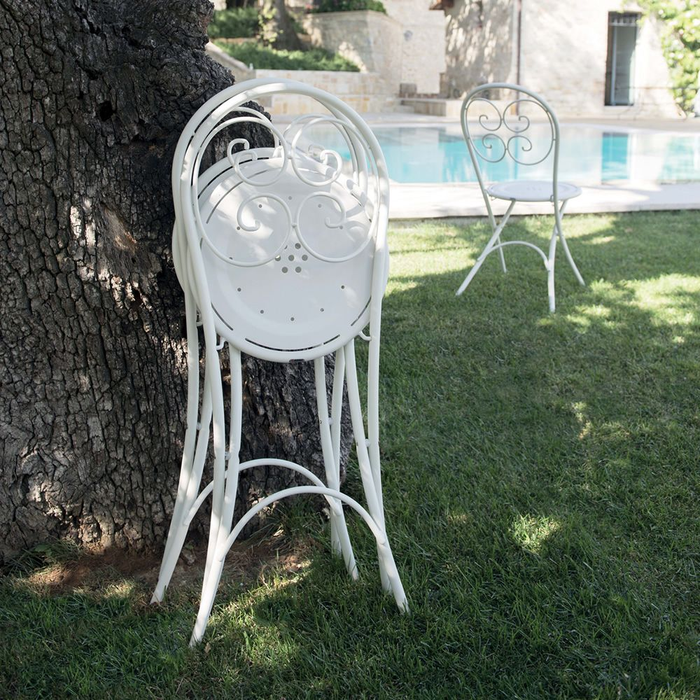 White varnished metal chairs