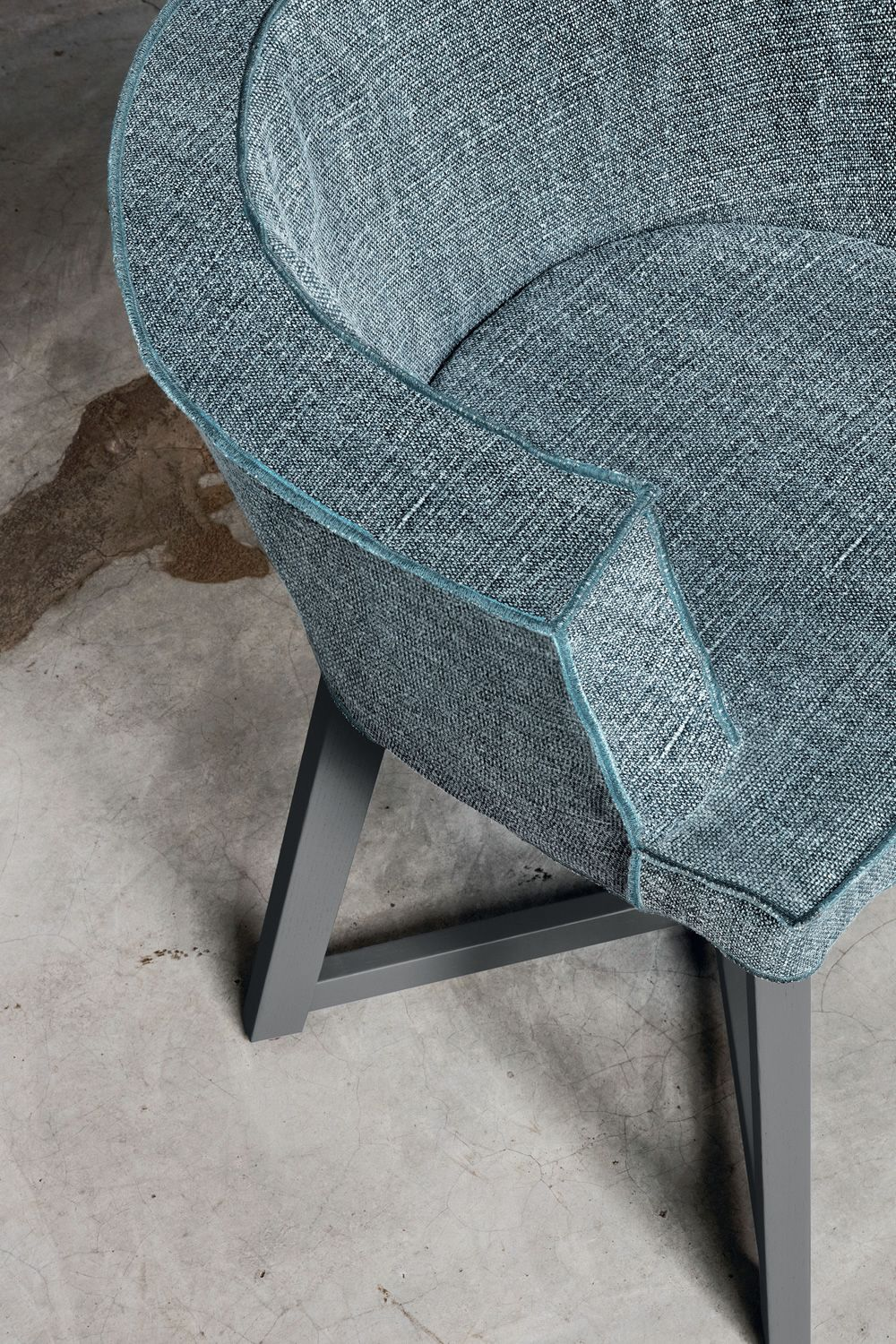Design armchair in grey lacquered wood, with padded seat upholstered and covered in Iuta fabric (fabric available upon request)