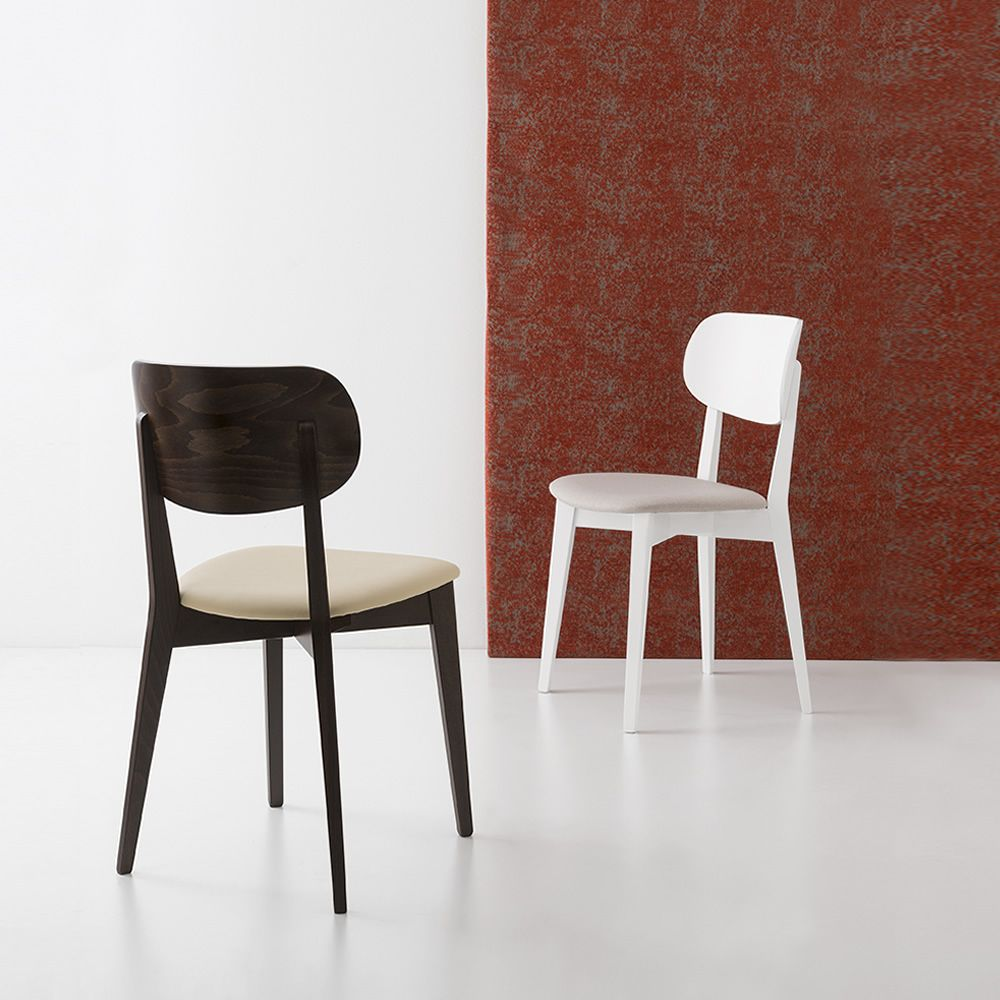 Chair in wengè dye or in white lacquered wood, seat covered with fabric or imitation leather