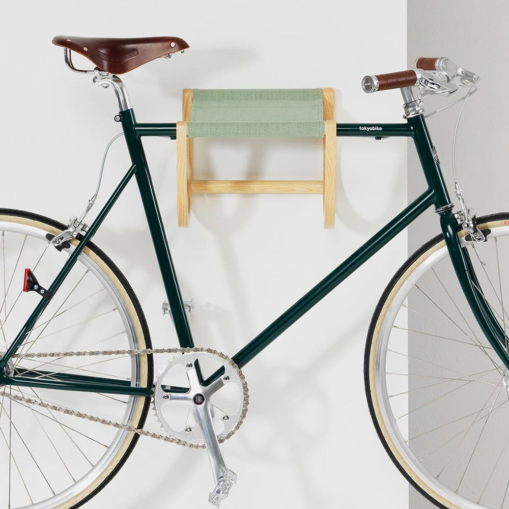 Wall-mounted bicycle storage in wood and light green Canvas fabric