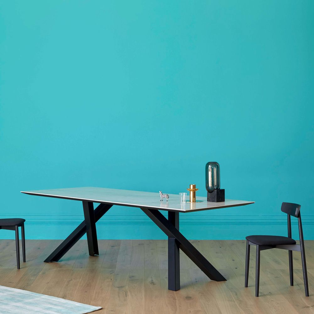 Rectangular table in black varnished metal, with top in Calacatta ceramic