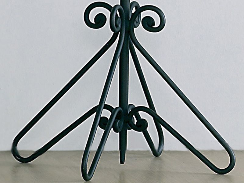 Detail of the coat stand in graphite varnished iron